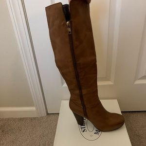 Rikki cognac leather boots by Steve Madden